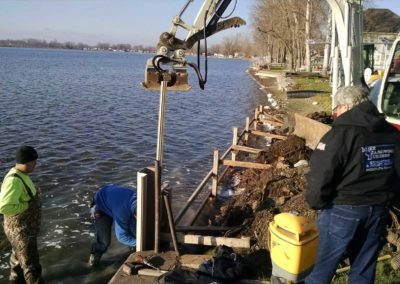 Driving sheet piles for a seawall project at Lake of The Woods in Bremen, IN